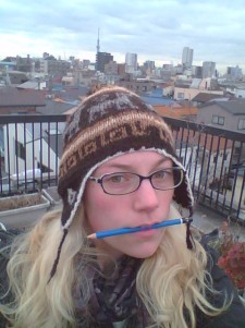 Me on the roof of our hostel, Skytree in the background